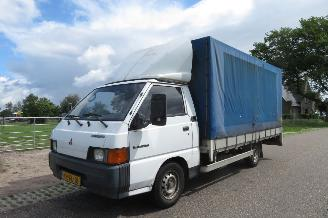 damaged commercial vehicles Mitsubishi L-300 2.5 TD LANG OPEN LAADBAK / PICK-UP MET HUIF EN N.A.P. MARGE AUTO 1997/3